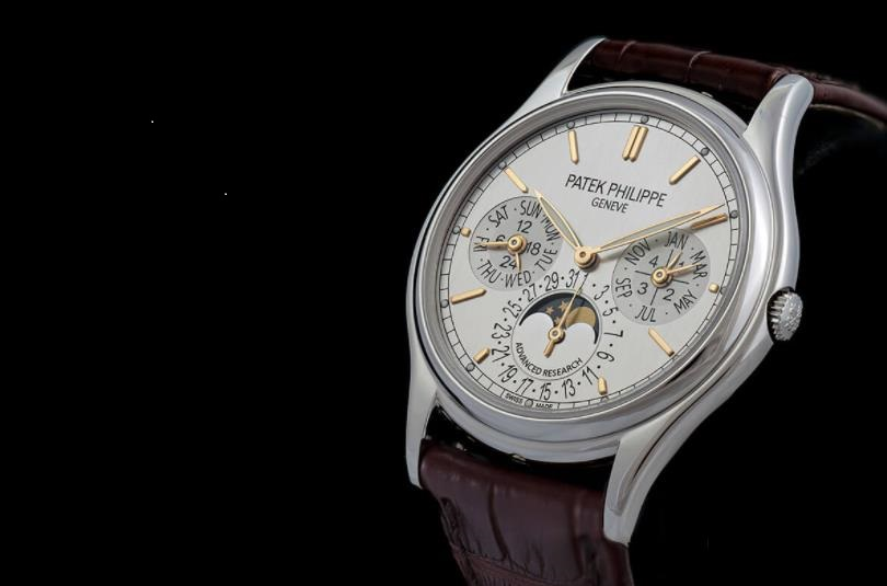 The silvery dial fake watch has a brown strap.