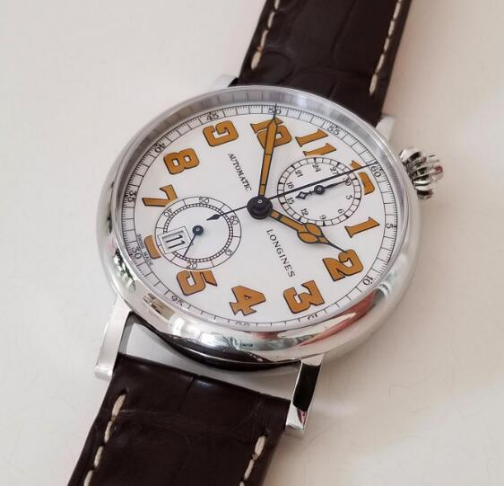 The vintage Arabic numerals hour markers are contrasted to the white dial.